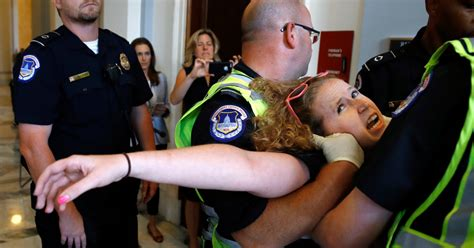Police Remove Disabled Protesters Outside Mitch McConnell