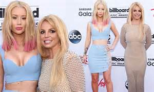 Britney Spears and Iggy Azalea pose arm in arm at the