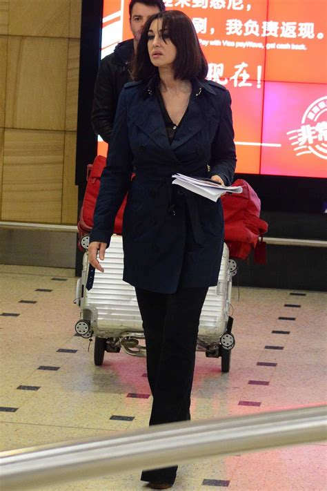 Monica Bellucci spotted at the airport as she touch down